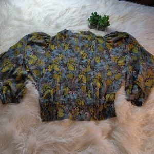 Floral dolman sleeve sheer button front blouse.